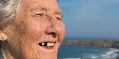 Old people are smiling with almost porous teeth