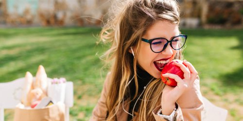 young women eating apples