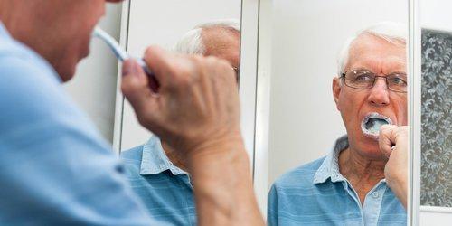 Grandfather is brushing his teeth