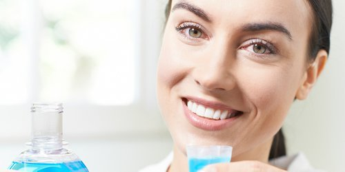 a doctor is holding a mouthwash