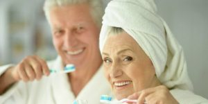 grandfather and grandmother brushing teeth