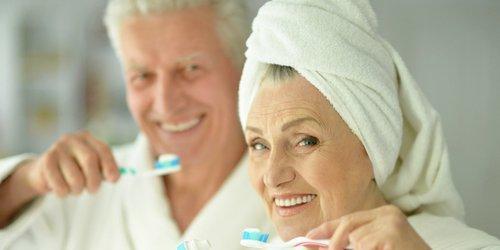 grandfather and grandmother brushing teeth