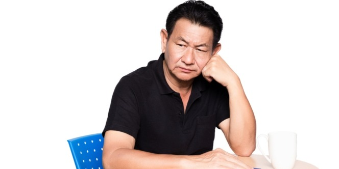 man sitting on the chair thinking about his mouth problem